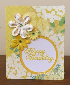 birthday card with yellow flowers and circle cutout